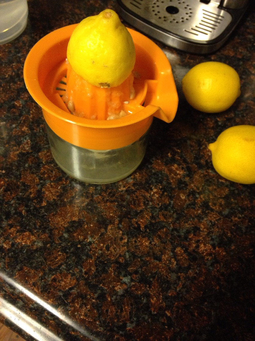 Four lemons juiced added to 2 liters of water