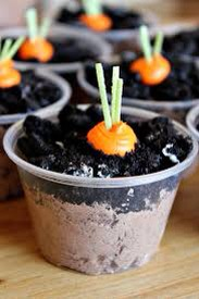 Directions: 1) Fill cup 3/4 with chocolate mousse 2) Fill rest of cup with crushed Oreos 3) Dot orange frosting onto the Oreos and stick a few strands of edible easter grass into the top 4) ENJOY! 😋