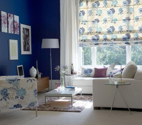 Flower Power Here's a bloomin' brilliant idea: Keep oversized patterns in check by limiting them to well-defined spaces (here a bouquet of blue flowers covers an occasional seat and an oversized roman shade). It will keep the powerful pattern from taking over the room.