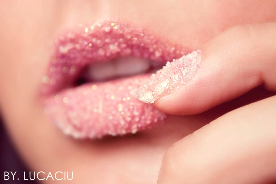 Rub sugar on your lips. You can really use any coarse food product, but avoid irritants like salt that will actually dry out your lips.