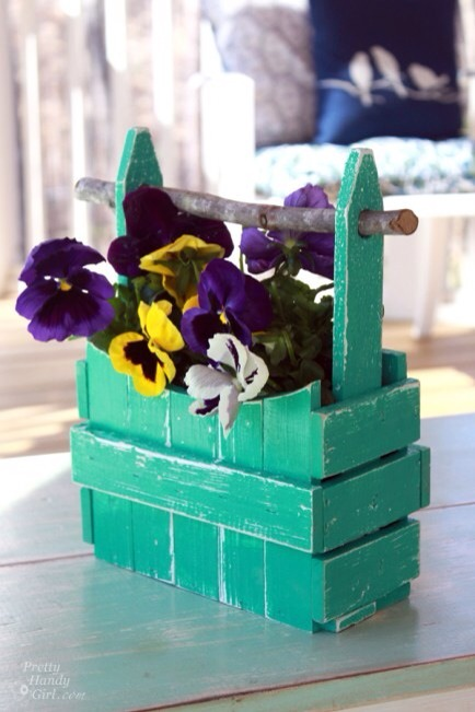 Picket Fence Planter  This planter's easy to make -- just some easy nailing -- and it's super cute. You can paint it any color you like to match your outdoor decor or even the plants you plant in it!