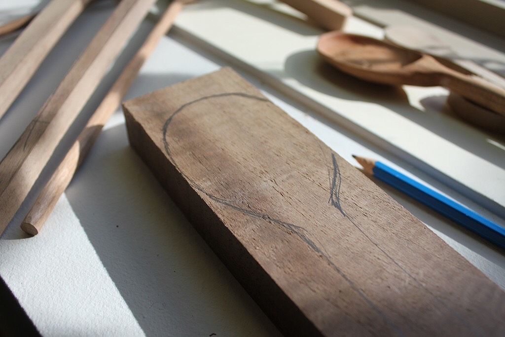 STEP ONE:  With your pencil, draw a spoon shape on your piece of wood then cut the shape out with a band saw. (If you don't have access to a saw, you can also purchase spoon blanks.)