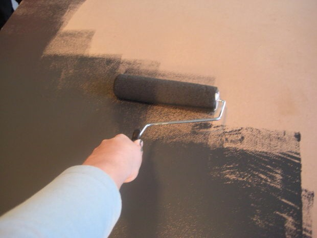 Paint the table surface with chalkboard paint. You can cover the top with your fine roller and the edges with your brush. Apply a thin and even coat and then let it dry as directed.