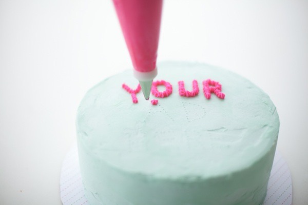 For professional looking icing writing dot the letters in with a toothpick first
