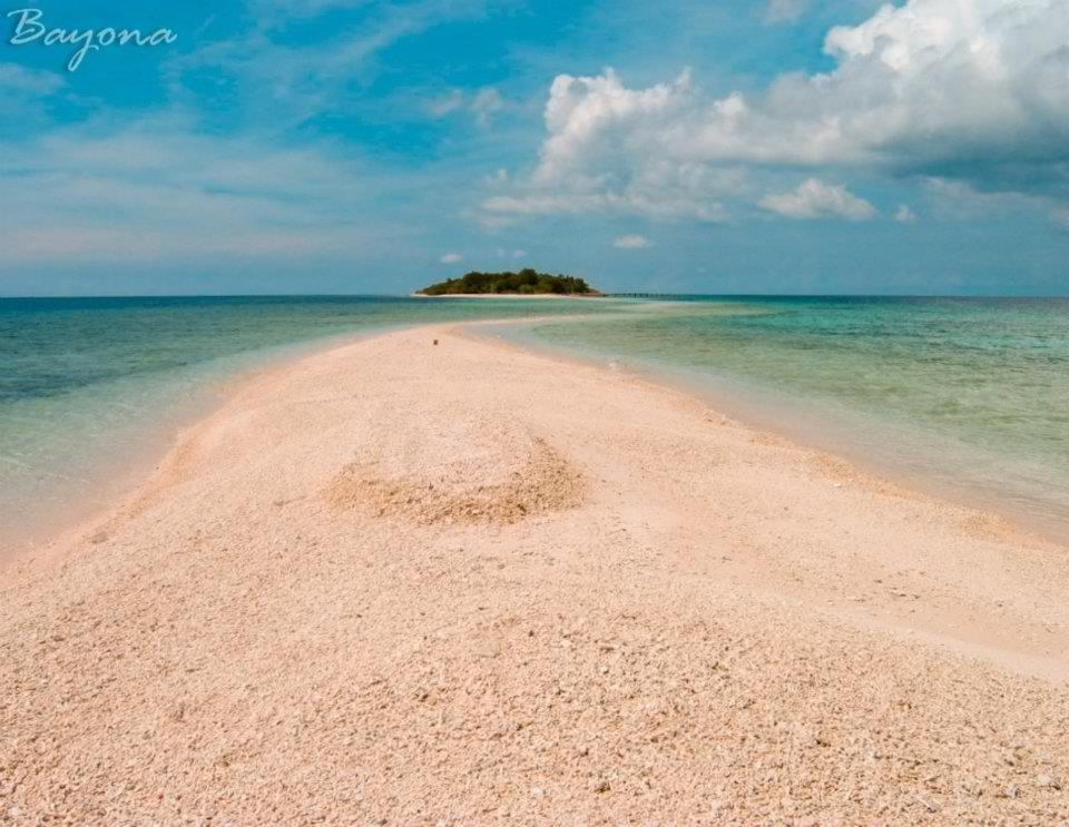 Sta.Cruz island  is a small inhabited island in Zamboanga City in the southern region of the Philippines that is famous for its pink coralline sand.