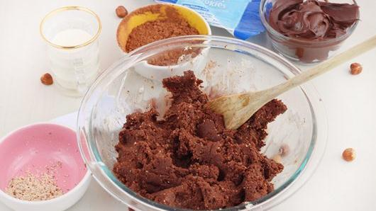 1) Break up cookie dough into medium bowl. Add hazelnut flour, cocoa and whipping cream; mix with wooden spoon until well combined and chocolate dough is formed. Shape dough with hands into 30 balls.