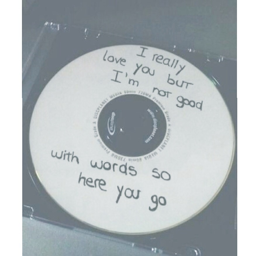 "Music is one of my favorite things ever. It gets the message across easily. Fill the cd with songs that mean something to the both of you. If you're one of the couples that have ""your song"" this is the best idea for you."
