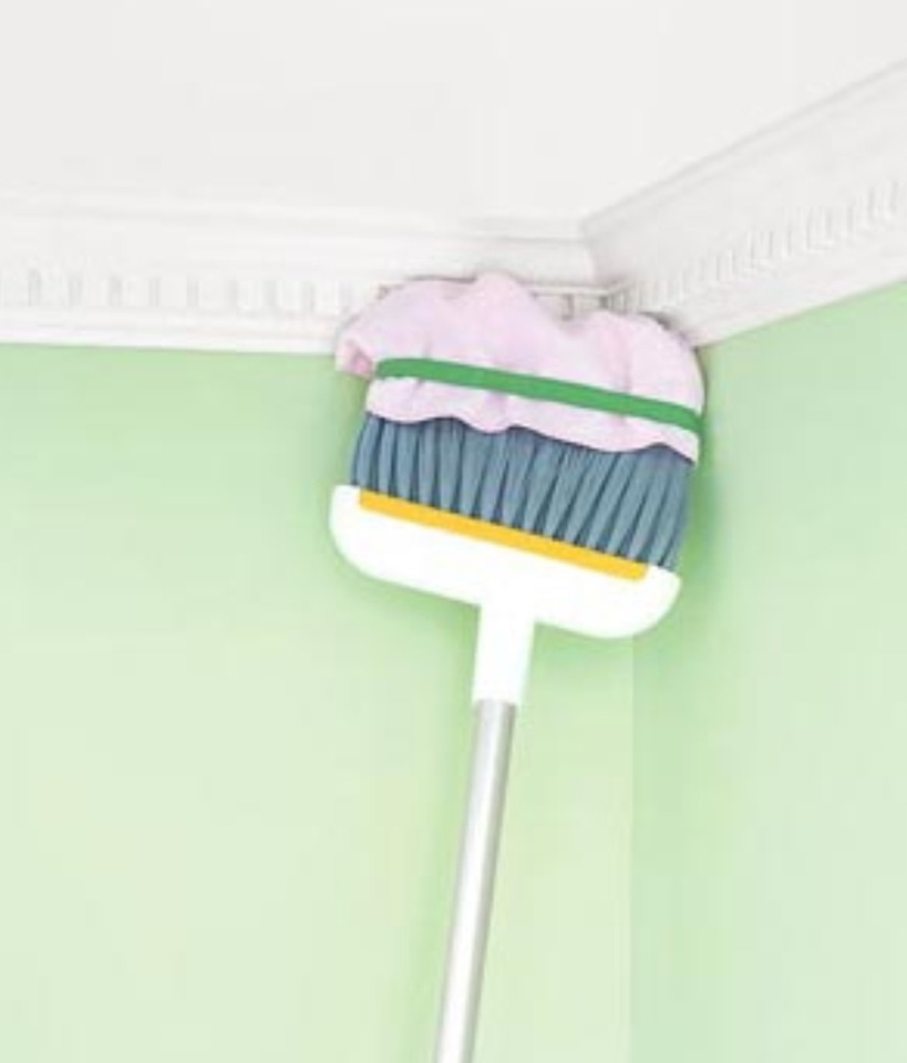 Broom as Long Distance Duster To dust crown moldings, place a microfiber rag over the broom's bristles and secure with a rubber band. Then use the long handle to dust areas that your arms can't reach. No more circus acts (starring you, on a rickety, wobbly stool).