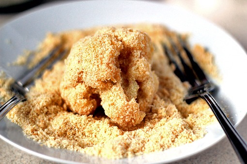 12. Then place the breadcrumbs in another bowl and roll the egg-covered floret in the breadcrumbs until nicely coated.     13. Repeat this process with all the remaining florets.