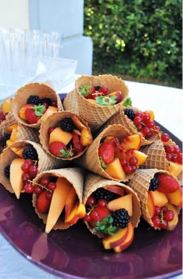 Putting frozen fruit into waffle cones is a great healthy alternative to ice cream on those hot summer days!