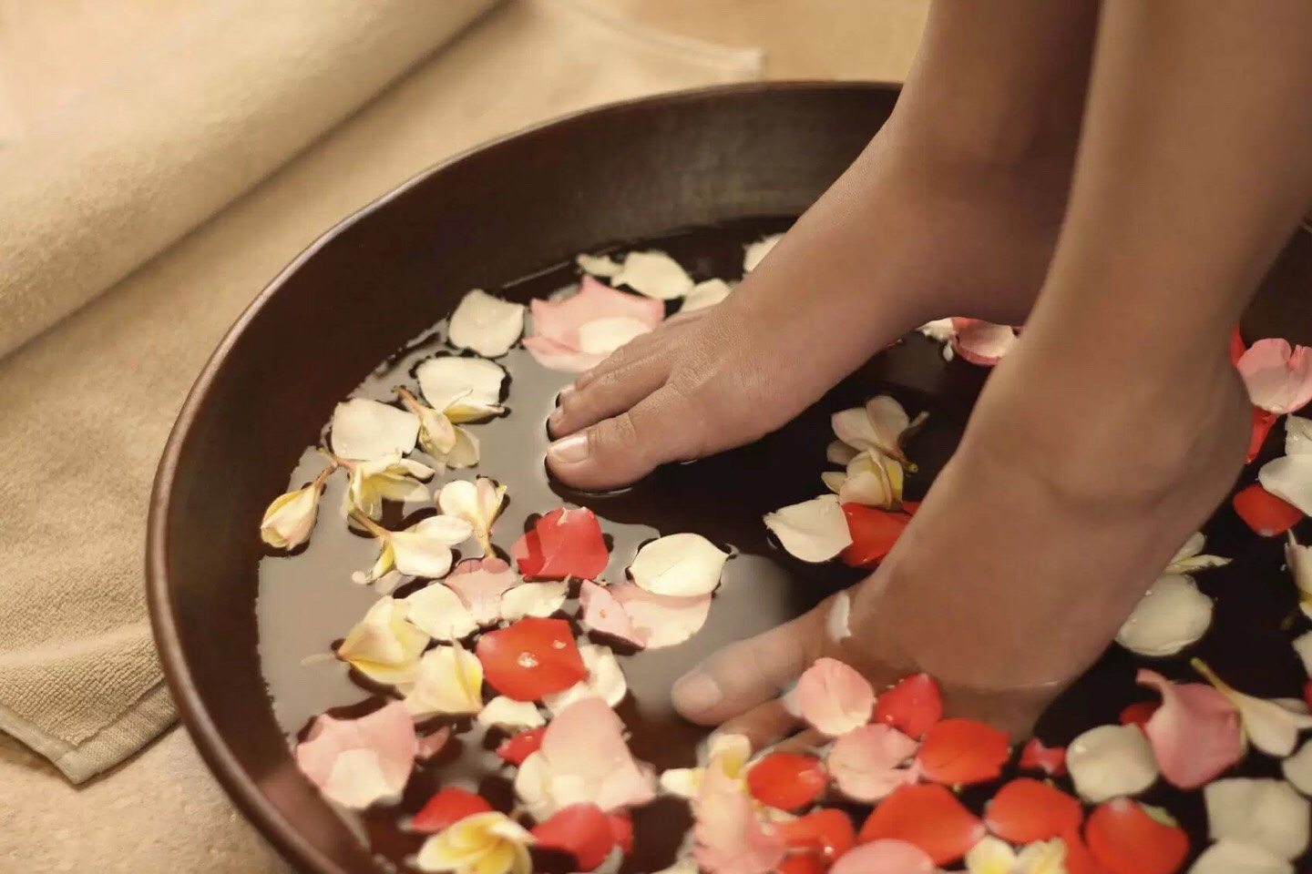 Giving yourself a pedicure... Choosing a ravishing color is beyond! You can add rose pedals if you want the spa treatment, but it's not required.