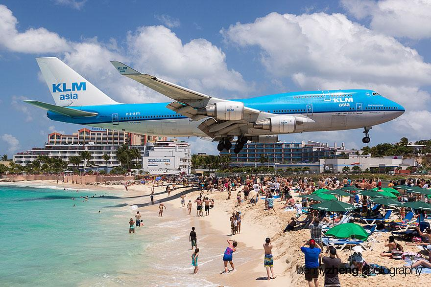 Maho Beach This beach's location is adjacent to the Princess Juliana International Airport in Saint Martin, it's almost easy enough to jump up and touch a flying airplane! Most people visit it in order to feel the extreme turbulence and power caused by the airplanes.