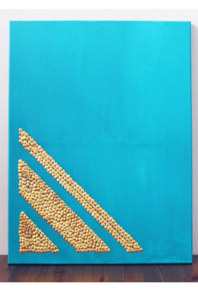 Paint a canvas any colour and use gold thumbtacks to create a beautiful design.  Please like :)