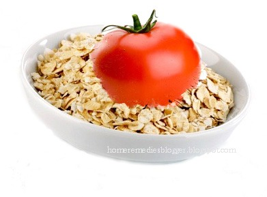 Ingredients: 1 tomato  1 c rolled oats  Take the oatmeal and blend it until it becomes a powder.  Mash the tomato so that it's a pulp that you can mix with the oatmeal.  Add enough to make a paste for your face.