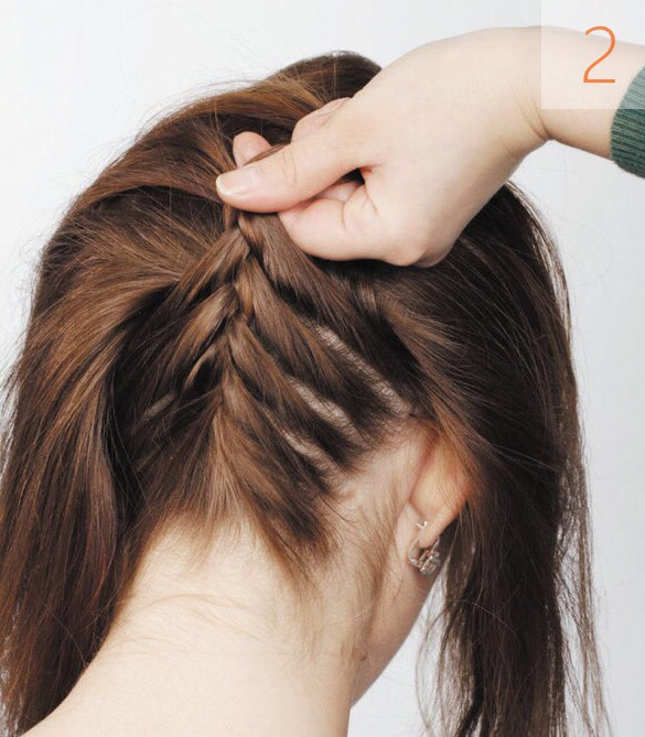 Intertwist the strands and then gradually add new strands from the sides that is, do the same action as if your making a simple French braid, only in the opposite direction.