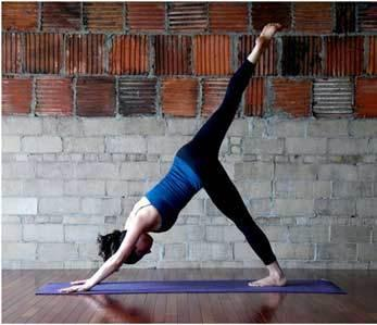 8. Three-legged Dog Pose: Start with the downward dog pose. Lift your right leg high up in the air supporting yourself on two hands and your left leg. Hold for five breaths, put your leg down and repeat with the other leg too
