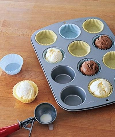 Before the party begins, prepare individual scoops of ice cream in a muffin pan filled with liners. When it's ready to be served, you can take it out of the freezer and quickly and easily serve it with the cake.