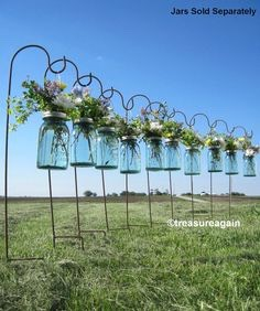 Hanging votives/ vases.  Just collect empty jar, like pasta sauce.  Twist a bit of wire around the top. Leave a bit of a tail to make a large loop from the top. Join to the other side of the jar. Done!!! Just add flowers!!! Amazing