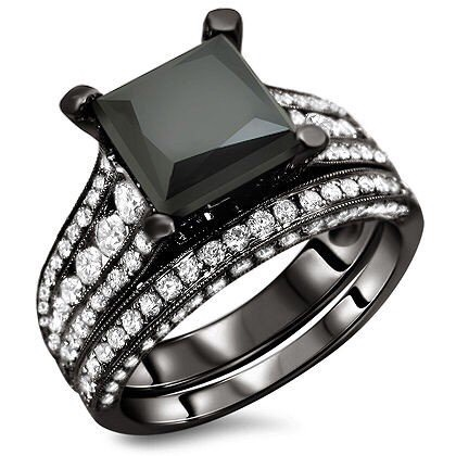 If I ever decide to get married again.... what kind of ring would I want? Black diamonds in rhodium is my answer.