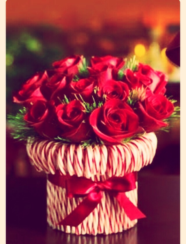 Roses on a vase then simply attach candy canes to it! Super easy and cheap
