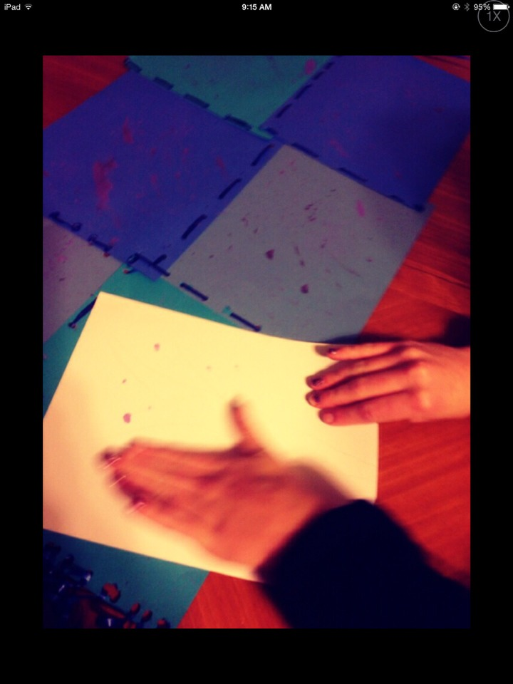 If you're too excited to get onto the next part to let it dry, like we were, you can use a piece of blank paper and carefully dab it over the paint splatters. Careful not to smear!