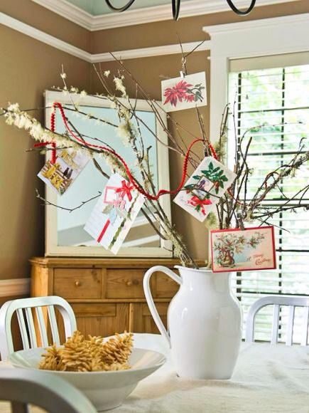 """Card-display tree  Show off Christmas cards on a centerpiece """"tree"""" made with twigs from the yard. Arrange twigs in a pitcher or vase, and clip or tie cards to twig ends. For an added burst of holiday color, weave a red ribbon or piece of rickrack through the display."""
