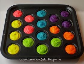Full the pan with cupcake batter and put the food coloring colors that you want in them