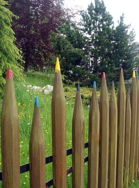 Use paint and make the tip of ur fence sharp and paint it to look like colour pencils .