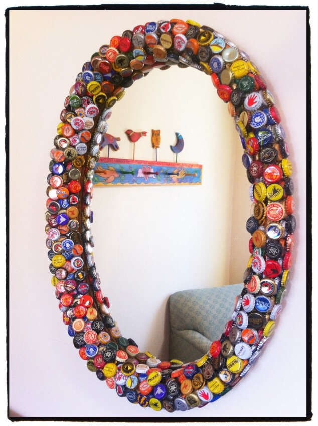 A bottle cap mirror/picture frame.