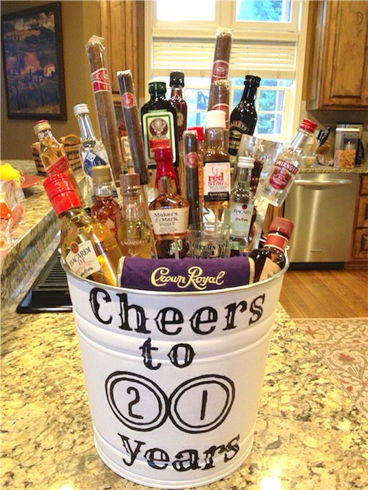 6. Liquor Bouquet This has got to be the ULTIMATE man gift — liquor bottles, cigars, beef jerky sticks, and shot glasses. Perfect for a 21st birthday! A smaller version in a large beer mug would also be nice.