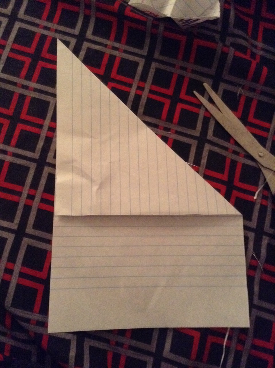 2) Fold it as if it looked like the little sails of a sail boat.