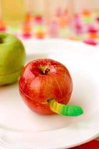 Cut an apple in half then carve a small opening to fit the gummy worm. Super cute and delish!