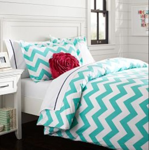 Get a duvet cover for you bed. It's bigger than normal bed covers and it folds over your bed making it look a lot nicer.