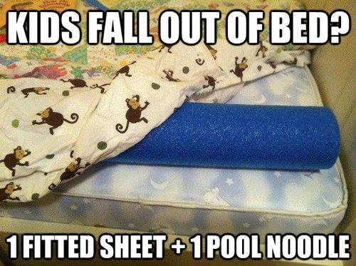 keep kids from falling out of the bed with a fitted sheet and a pool noodle