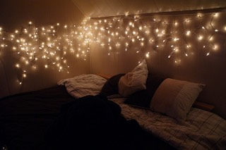 7. Bed board: String lights along the headboard of your bed for a soft, warm look to your room.