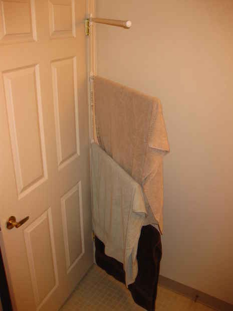 3. Hang towels and things on the back of your door.