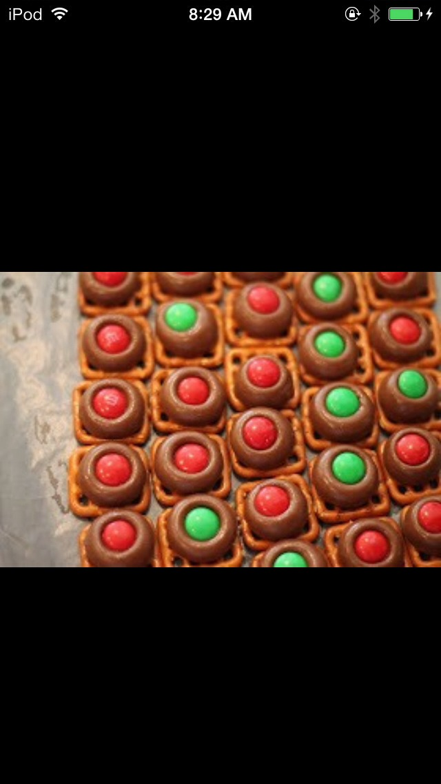 Preheat your oven to 170 degrees. Put a piece of wax paper on a cookie sheet. Place pretzels on the wax paper.U Place one Hershey's Kiss on top of each pretzel. Bake for 4-6 minutes depending on your oven.  Remove from oven and press one M&M into  the center. Allow to sit and cool for a few hours
