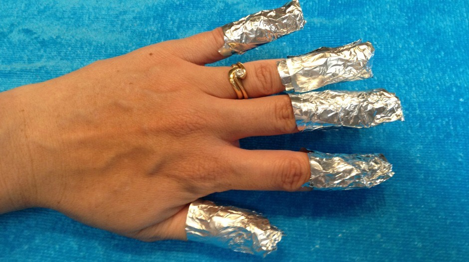 Curl the foil, with the cotton ball in, around your finger. Then leave for 10 minutes