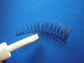 Step 1: Apply the lash glue to the bands of the false eye lashes.