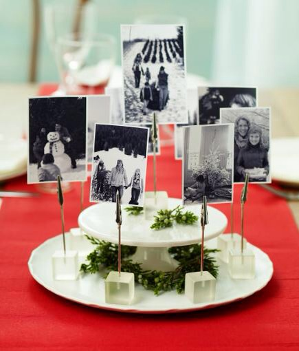 Focus on family  Make family photos the focus of your centerpiece. Choose pics from Christmases past for a trip down memory lane. Place two photos back-to-back on memo clips, so you'll be able to see a picture no matter where you sit. Set photos on a cake stand or plate using frosted gel memo cubes