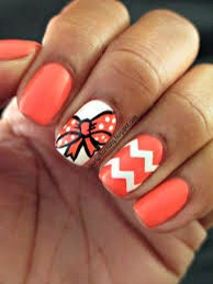Coral looks amazing for holiday nails