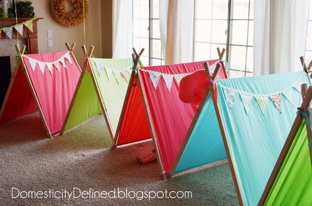 2. DIY these easy-to-make pup tents so each of your guests has their own space to slumber.