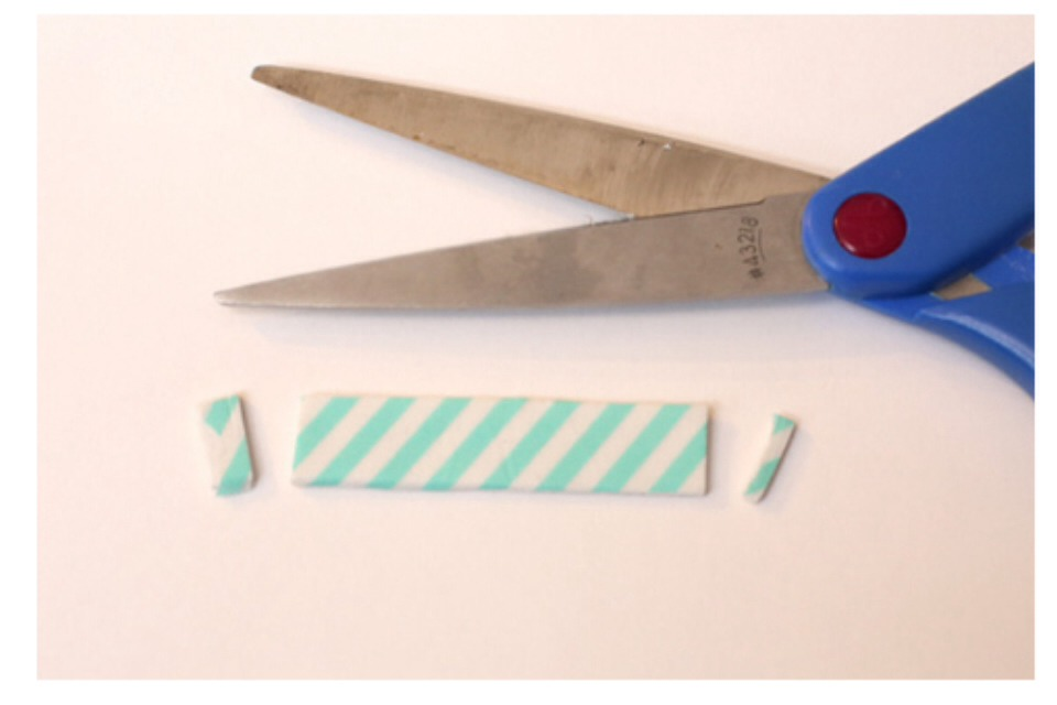 (2) Snip around the tape to create 2 clean ends.
