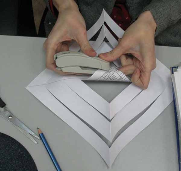 3. First fold the smallest stripes toward each other and staple them together.