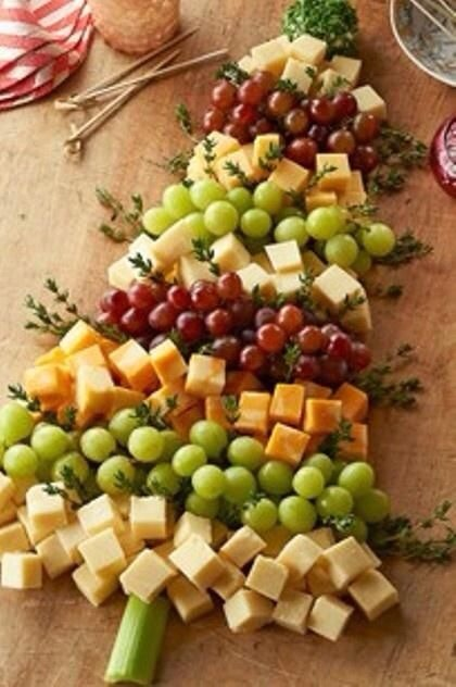 Add your favorite cubed cheese, seedless grapes, thyme for branches, 2 tablespoon cream cheese spread 2 tablespoons of fresh finely chopped parsley and 1 2in piece of celery...layer the cheese and grapes as shown stick thyme in for decorations, roll cream cheese in ball then roll around in parsley.