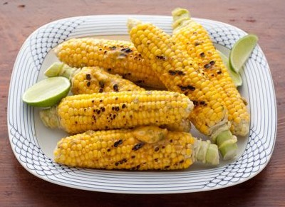 JALAPEÑO-LIME CORN ON THE COB Total Time: 25 min | Yield: 6 servings  INGREDIENTS: 1 stick butter 1 lime, juiced and zested 1 small jalapeno, seeded 1 clove garlic 1 teaspoon sweet paprika 6 ears corn on the cob, husked 1 slice bread, of any kind  Coarse salt