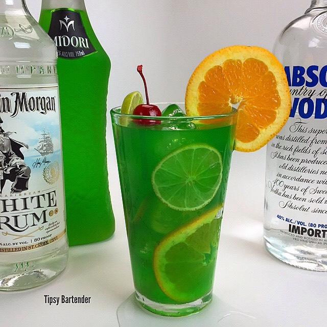 1 1/2 oz. (45ml) Vodka 1 oz. (30ml) Rum 1 oz. (30ml) Blue Curacao 1 oz. (30ml) Midori 1 oz. (30ml) Lime Juice 3 oz. (90ml) Orange Juice 3 oz. (90ml) Pineapple Juice Enjoy! 💕