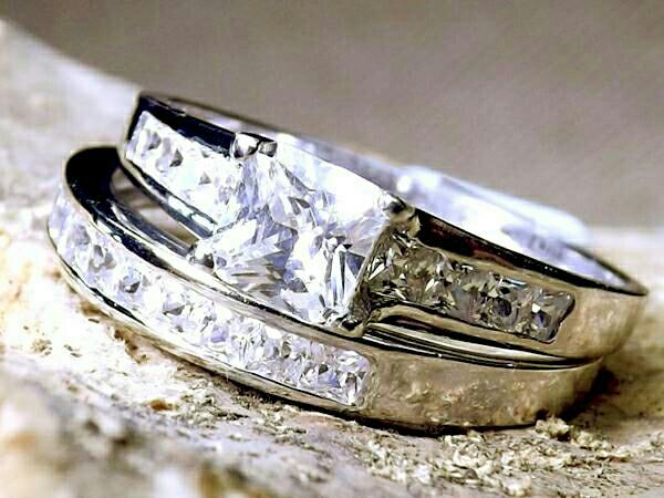 princess cut silver wedding ring.