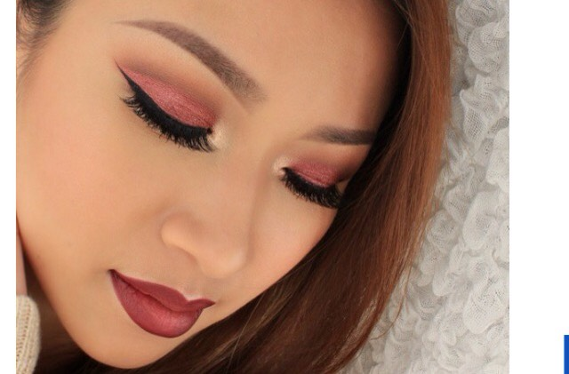 12. Shimmery cranberry eyeshadow, winged liner, cranberry lip.