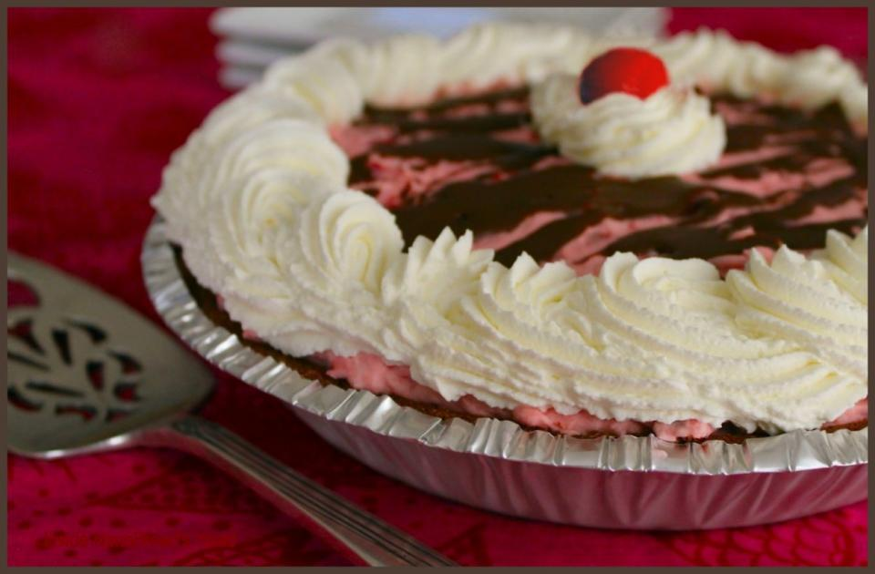 Spoon whipped topping over pie then artfully arrange the remaining cherry pie filling on top.